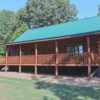 53+/- Acre Farm, Like new 1700 Sq Ft. Log Home at  for 419900.0000